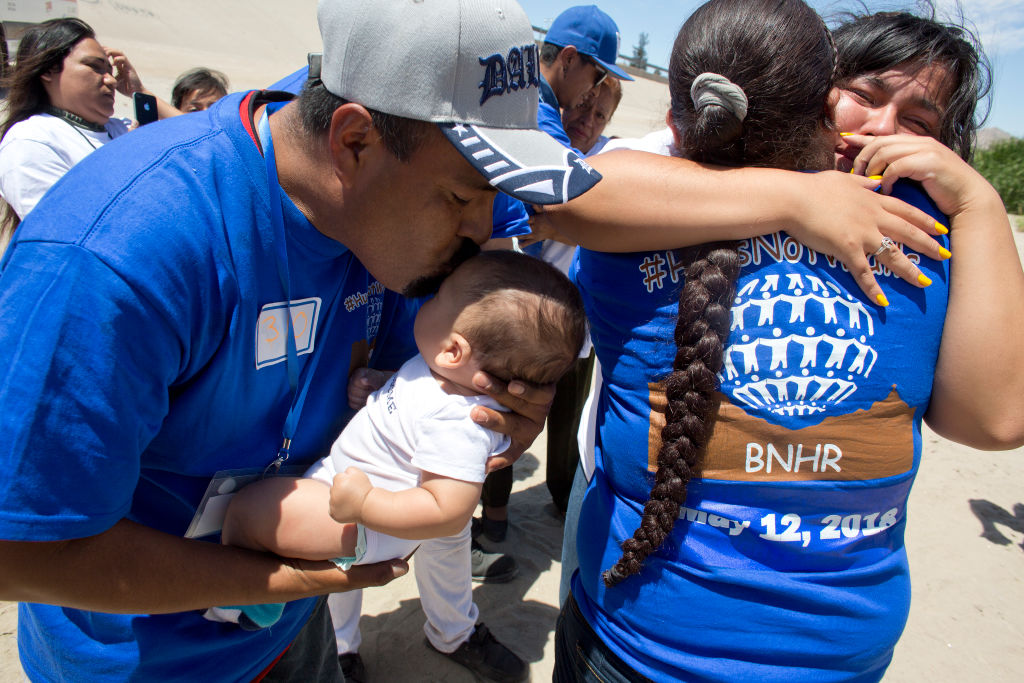 Latino families reuniting-hugging and kissing