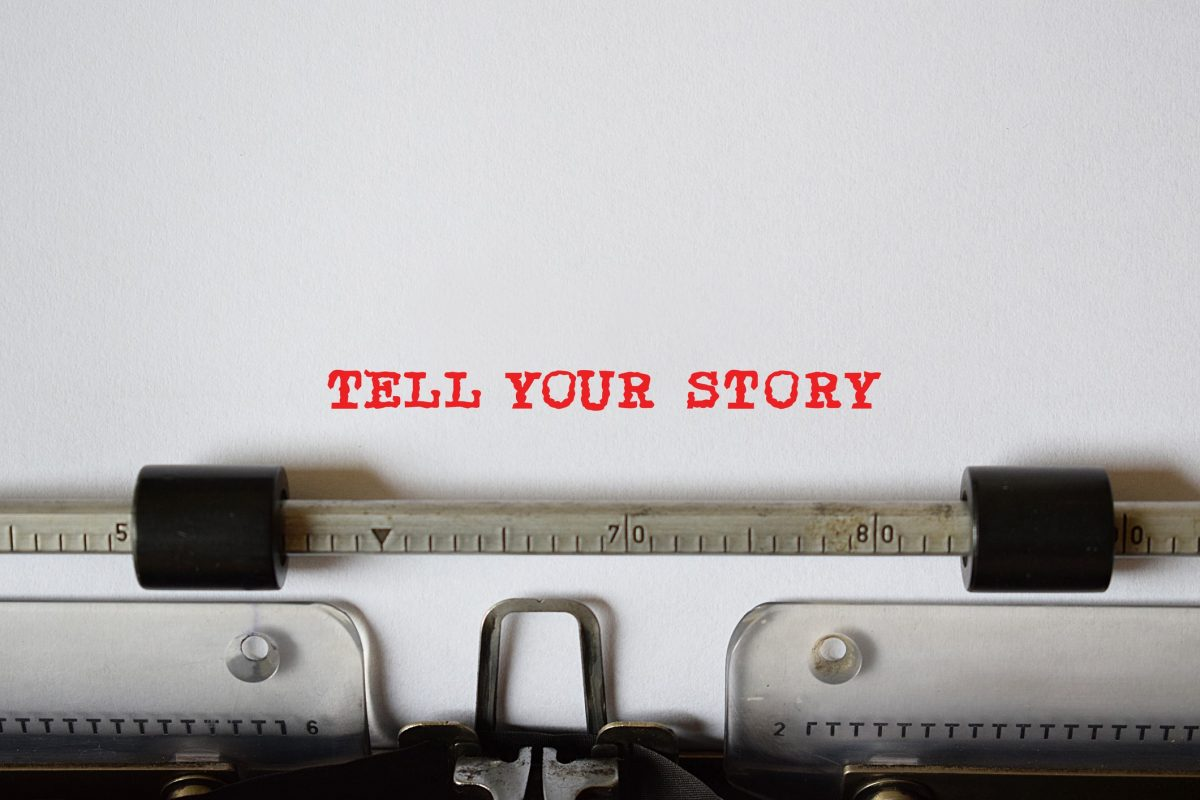 TELL YOUR STORY - typed on retro typewriter is photo made with unique words.