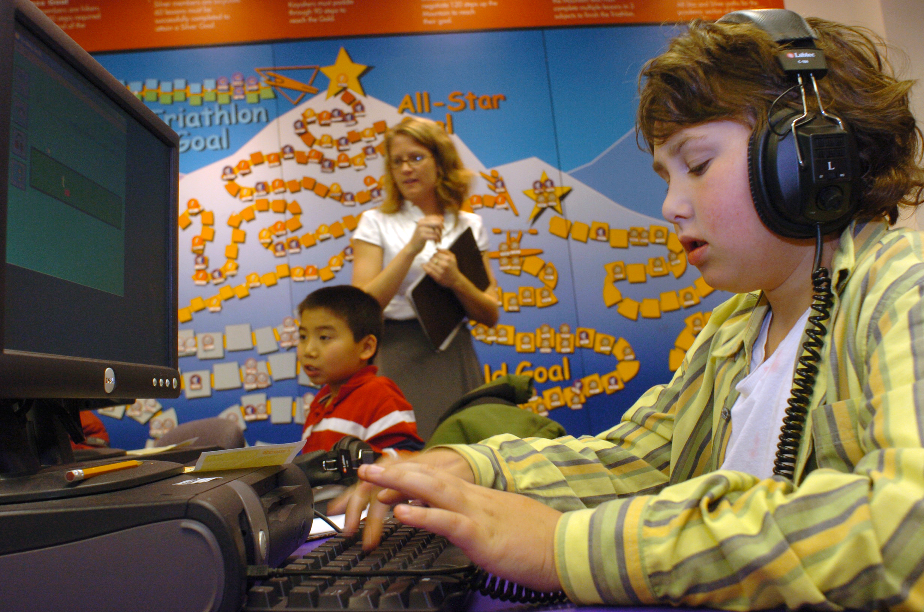Fifth grader working at the computer during his after-school learning