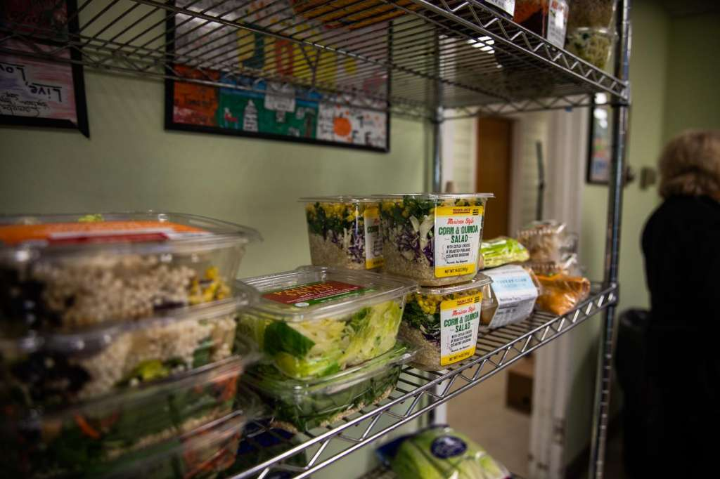 packaged salads on food pantry shelf
