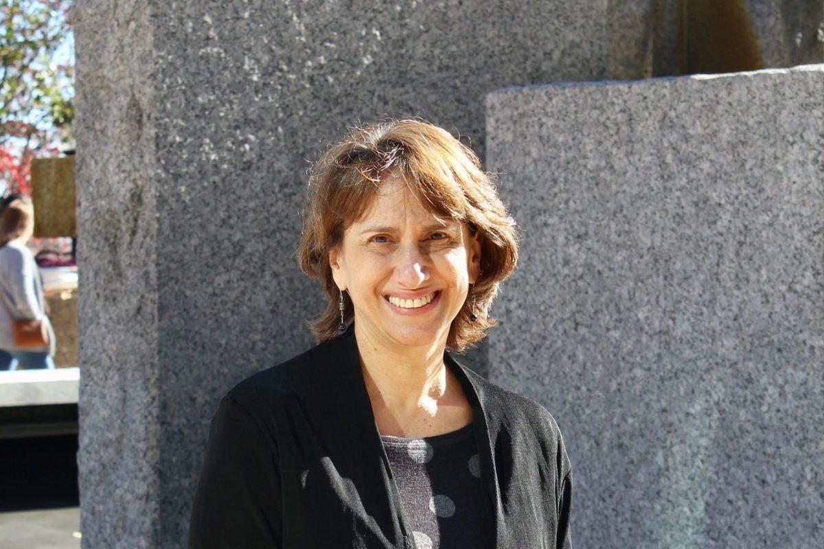 Marlene Schwartz sitting on fountain edge