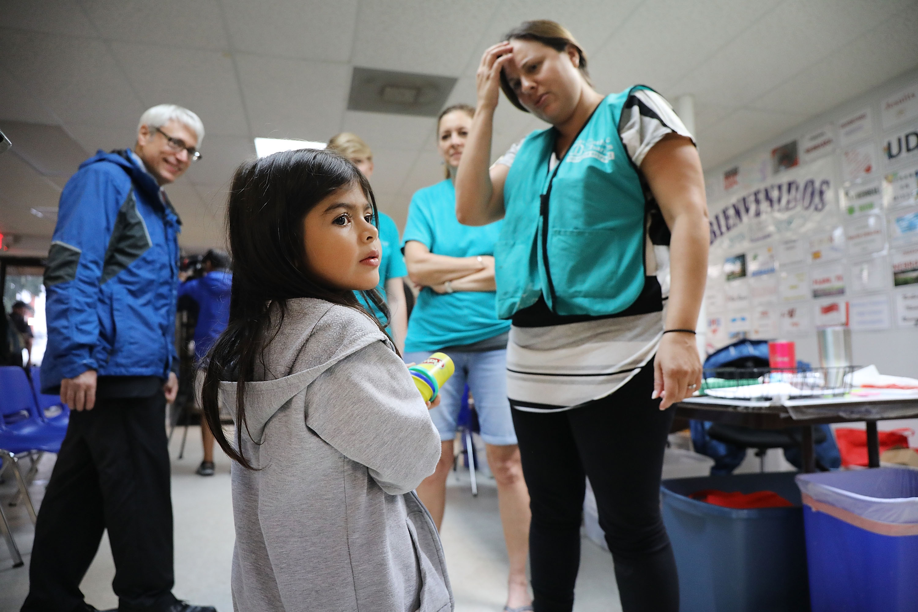 Jenquel, who crossed the U.S., Mexico border with her mother and siblings, speaks with volunteers at the Catholic Charities Humanitarian Respite Center in McAllen, Texas.(Spencer Platt/Getty Images)