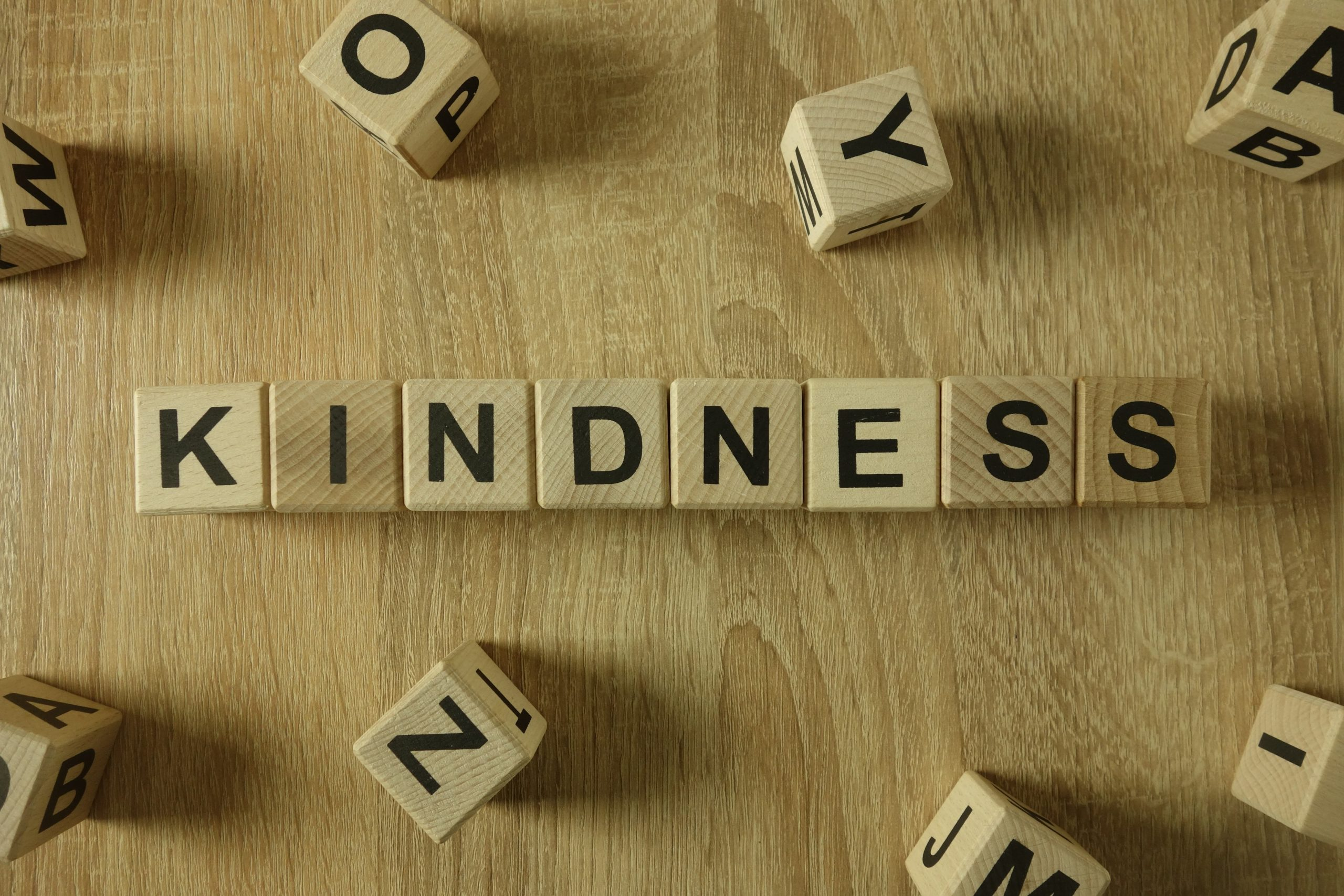 Kindness word from wooden blocks on desk