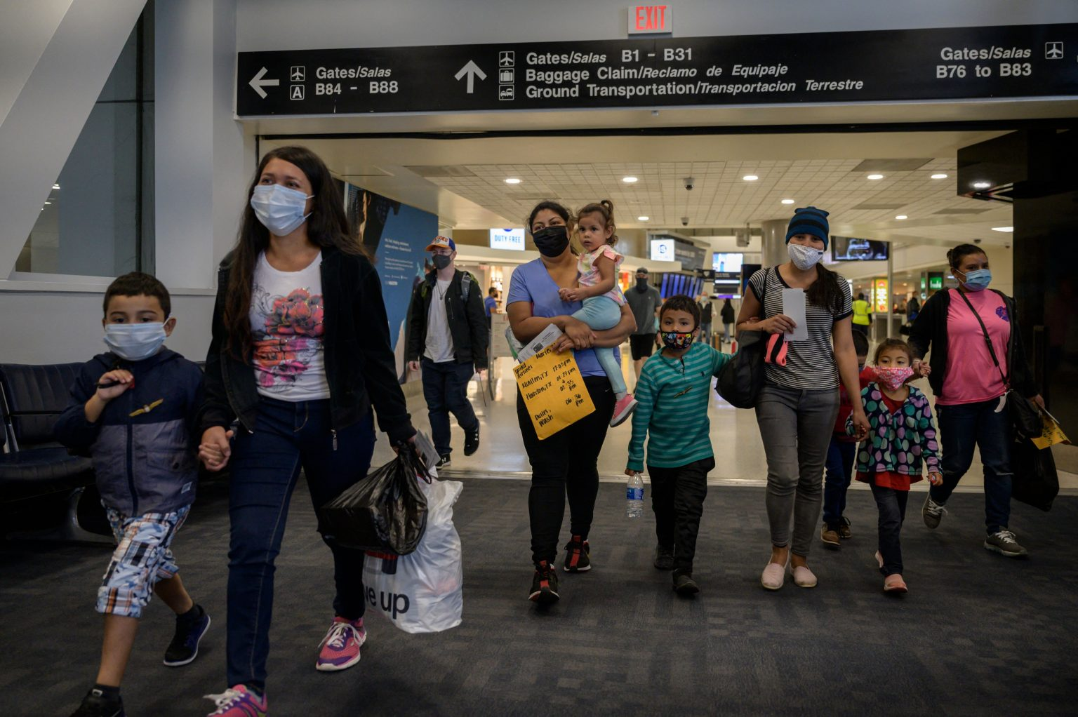 Parent and child Asylum seekers arrive in the US. at an airport