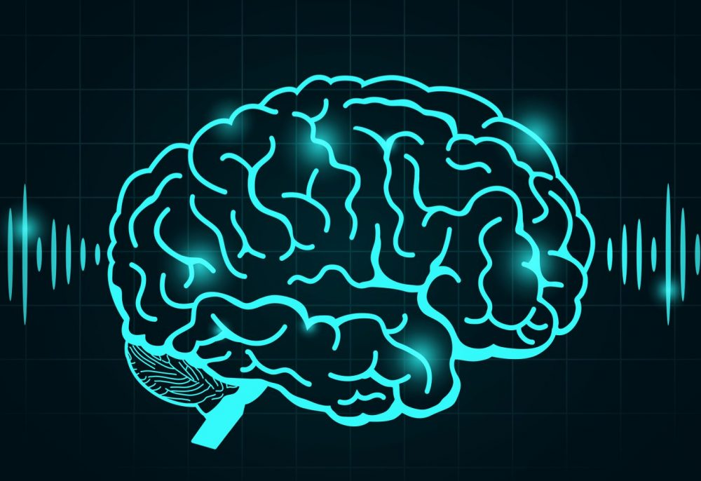 digital picture of brain in green/blue emitting waves
